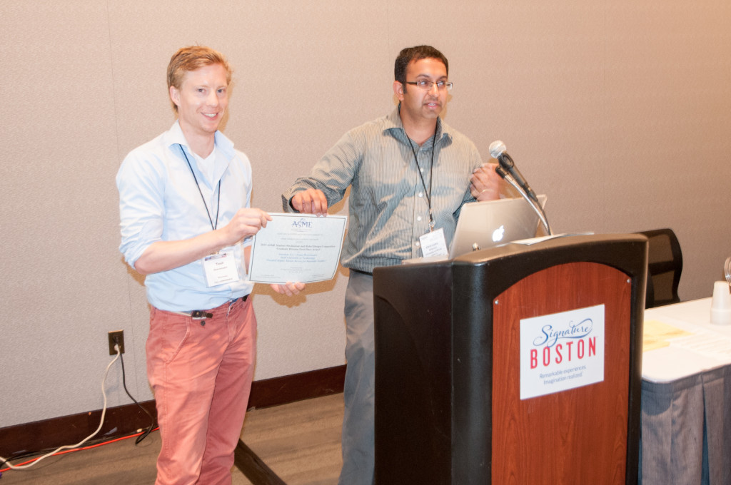 The 2015 Student Mechanism and Robot Design Competition award is handed to Teun by Girish Krishnan, the contest organizer